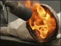 Burning out a wax pouring cup at John McKenna's  A4A art studio bronze foundry, Ayrshire, Scotland