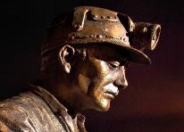 the Auchengeich miner bronze statue casting on site created at the John McKenna sculpture foundry