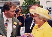 Her Majesty Queen Elizabeth II meeting the sculptor John McKenna and seeing his Jersey Cow bronze animal sculpture